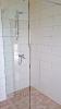Badezimmer in Holzoptik mit Glasdusche_1