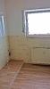 Badezimmer in Holzoptik mit Glasdusche_3