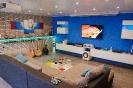 Wohnzimmer Renovierung mit Fliesen, Trockenbau und Vertäfelung_1